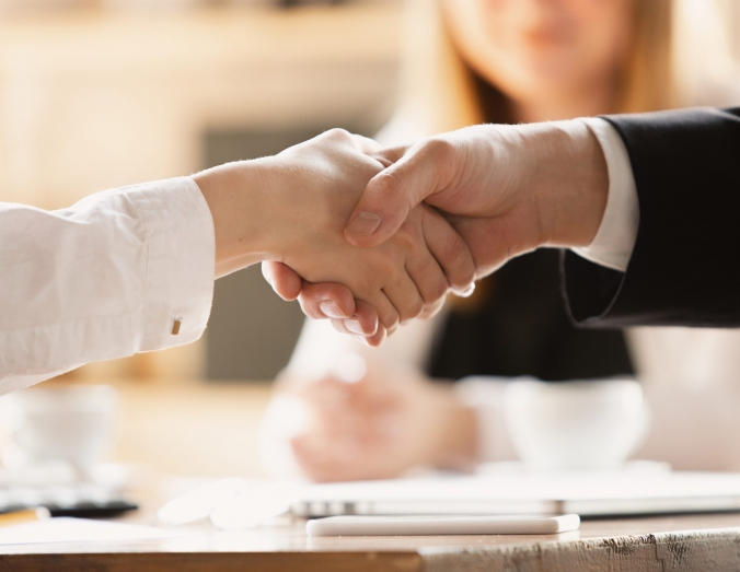 Conclusion of agreement, contract. Close up of caucasian human hands shaking, working in office. Concept of business, finance, job, online shopping or sales. Copyspace for ad. Education, communication.