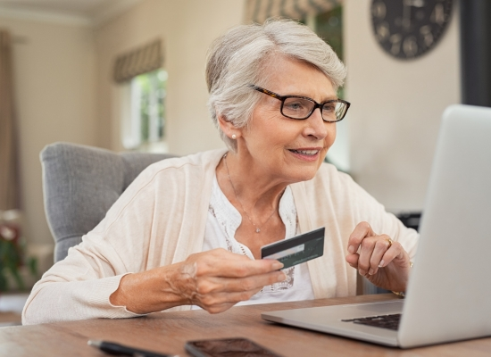 Old woman paying bills online